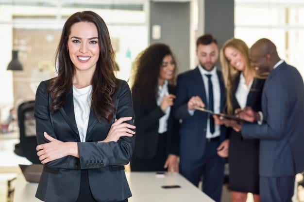 businesswoman-leader-in-modern-office-with-businesspeople-workin_1139-955